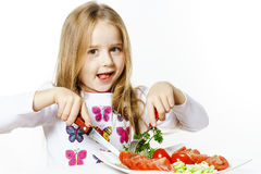 Cute little girl with plate of fresh vegetables Stock Photography