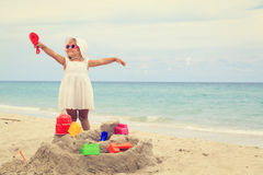 Cute little girl play with sand on beach. Family vacation Royalty Free Stock Photos