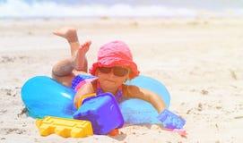 Cute little girl play on summer beach. Cute little girl play on summer sand beach Stock Photo