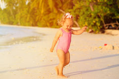 Cute little girl play at summer beach Stock Photography