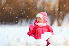 Cute little girl  play in winter snow Stock Photos