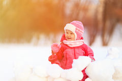 Cute little girl  play in winter snow Stock Photo