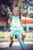Cute little girl on the playground Stock Images