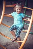 Cute little girl on the playground. Royalty Free Stock Photos