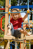 Cute little girl on a playground Stock Images