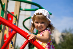 Cute little girl on playground Stock Photos