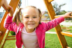 Cute little girl on playground Royalty Free Stock Photos