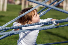 Cute little girl on playground Royalty Free Stock Image