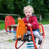 Cute little girl in playground Stock Photos