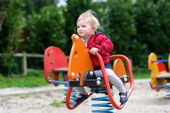 Cute little girl in playground Stock Photo