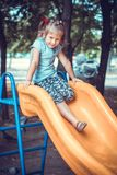 Cute little girl on the playground. Stock Photography