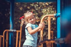 Cute little girl on the playground. Royalty Free Stock Photo