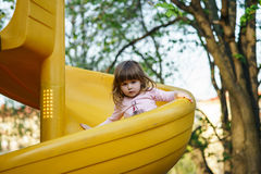 Cute little girl on playground Stock Image