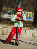 Cute little girl on the playground in spring park Royalty Free Stock Photography