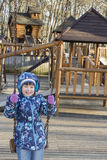 Cute, little girl in the playground in winter day Royalty Free Stock Image