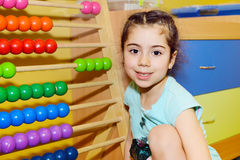 Cute little girl playing with abacus Stock Photography
