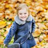 Cute little girl playing in autumn park Stock Photography