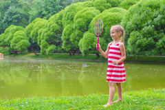 Cute little girl playing badminton on picnic Royalty Free Stock Photo