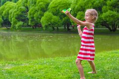 Cute little girl playing badminton on picnic Royalty Free Stock Photography