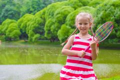 Cute little girl playing badminton on picnic Stock Photos