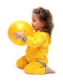 Cute little girl playing with ball royalty free stock photography
