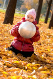 Cute little girl playing with ball Stock Photo