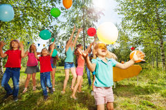 Cute little girl playing balloons with her friends Stock Photo