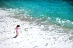 Cute little girl playing on a beach Royalty Free Stock Photos