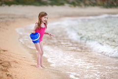 Cute little girl playing on a beach Stock Photography