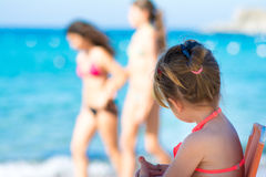 Cute little girl playing on the beach Stock Photo