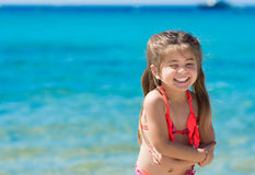 Cute little girl playing on the beach Stock Image