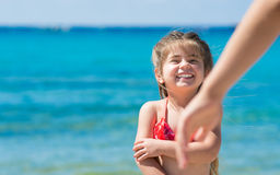 Cute little girl playing on the beach Royalty Free Stock Photos