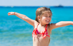 Cute little girl playing on the beach Royalty Free Stock Images