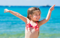 Cute little girl playing on the beach Stock Photography