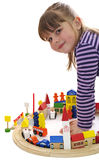 Cute little girl playing with blocks Royalty Free Stock Image