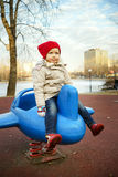 Cute little girl playing on child playground in public park Royalty Free Stock Photography