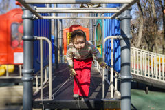 Cute little girl playing on child playground Royalty Free Stock Photo