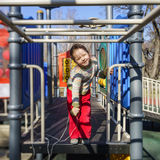 Cute little girl playing on child playground Royalty Free Stock Photos
