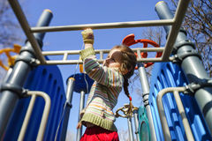 Cute little girl playing on child playground Stock Image
