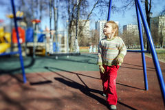 Cute little girl playing on child playground Royalty Free Stock Photography