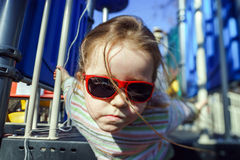 Cute little girl playing on child playground Stock Photos