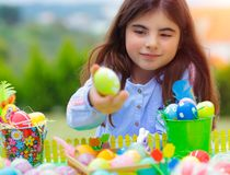 Little girl playing with Easter eggs royalty free stock images