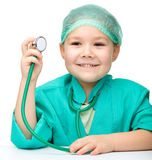 Cute little girl is playing doctor Stock Photos