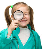 Cute little girl is playing doctor Royalty Free Stock Images