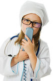 Cute little girl is playing doctor Stock Photo