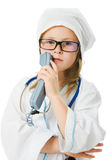 Cute little girl is playing doctor Royalty Free Stock Photography