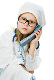 Cute little girl is playing doctor Royalty Free Stock Image