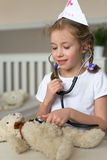 Cute little girl playing in doctor. Royalty Free Stock Images