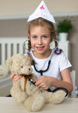 Cute little girl playing in doctor. Stock Images