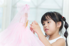 Cute little girl playing with doll at home . Royalty Free Stock Photo